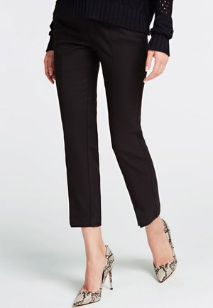 SOLEDAD - Trousers - black