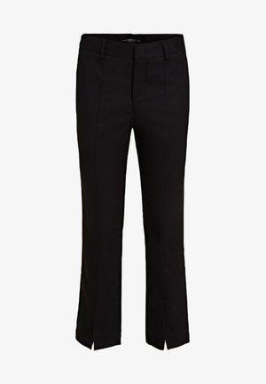 SOLEDAD - Trousers - black