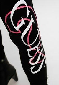 Guess - KASSY PANTS - Pantaloni sportivi - jet black - 3