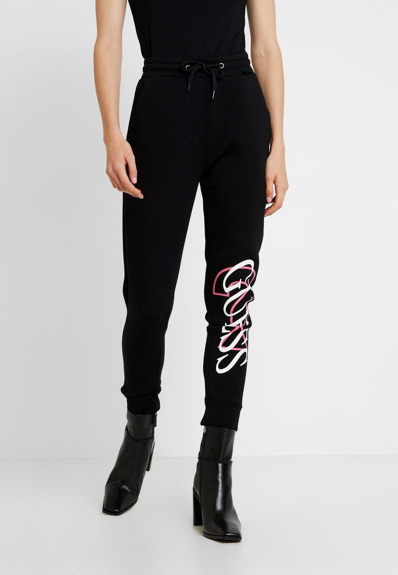 Guess - KASSY PANTS - Tracksuit bottoms - jet black