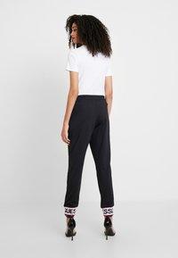 Guess - NINA PANTS - Teplákové kalhoty - jet black - 3