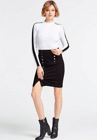 Guess - MIT KNÖPFEN - A-line skirt - black - 0
