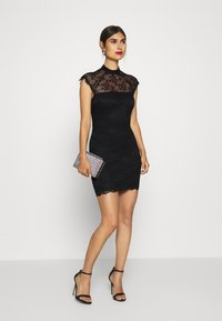 Guess - YOKI DRESS - Cocktail dress / Party dress - jet black - 1