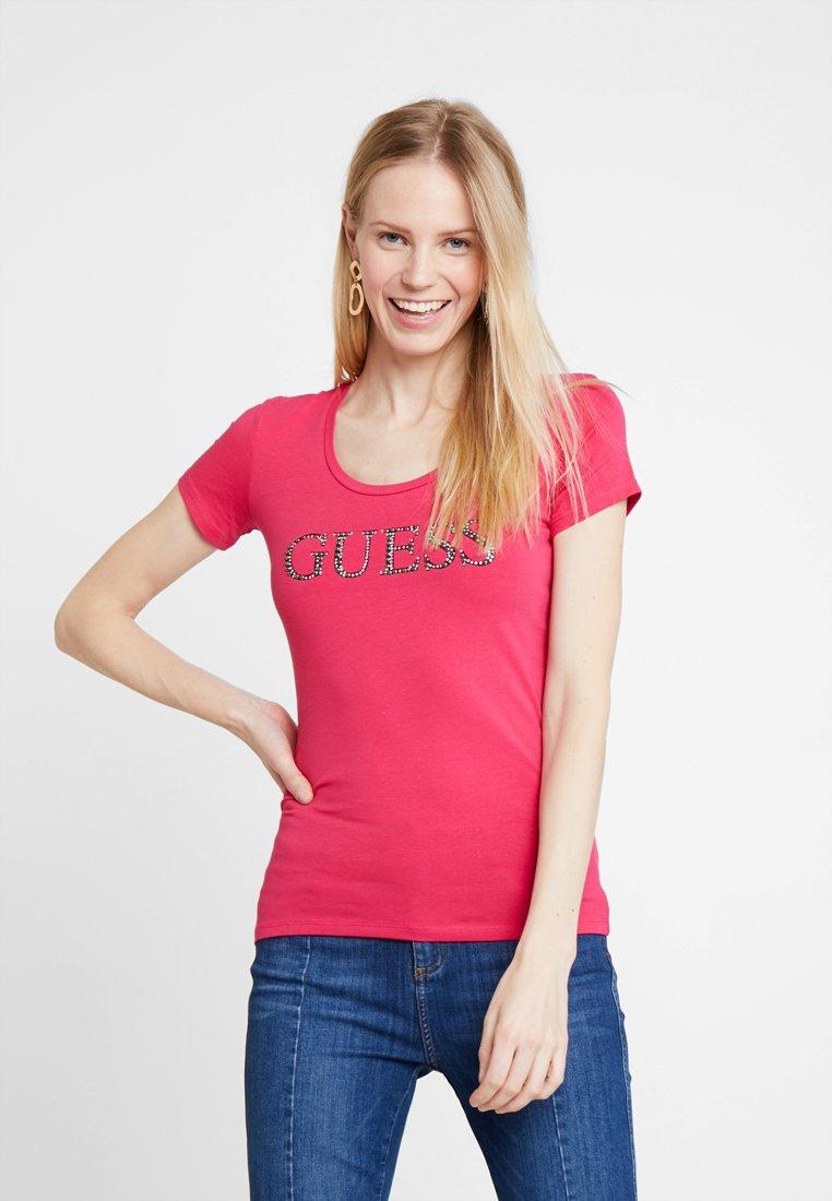 Guess - Camiseta estampada - pink