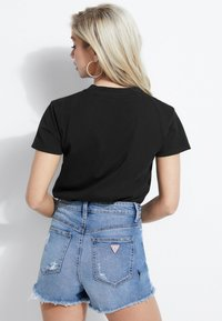 Guess - T-shirt con stampa - black - 2