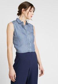 Guess - CALISTA  - Button-down blouse - pin blue - 0