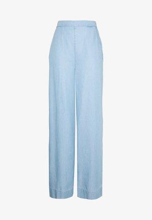IRINA PANT - Jeans a zampa - water