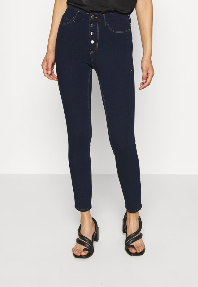 EXPOSED BUTTON - Jeans Skinny Fit - dark-blue denim