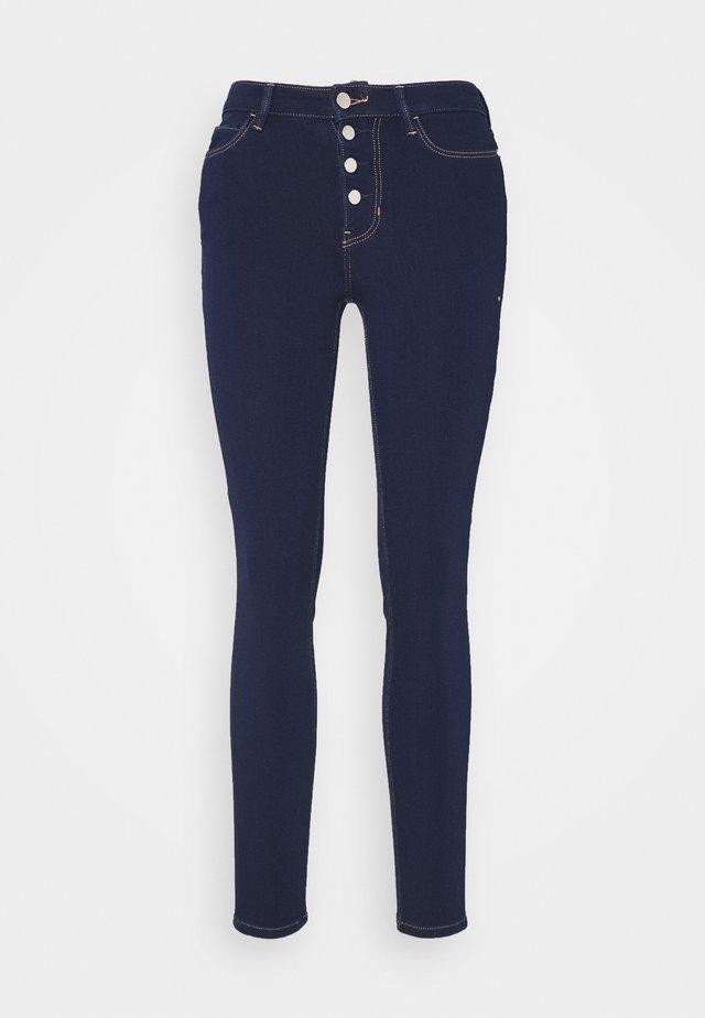 EXPOSED BUTTON - Jeans Skinny Fit - dark-blue denim
