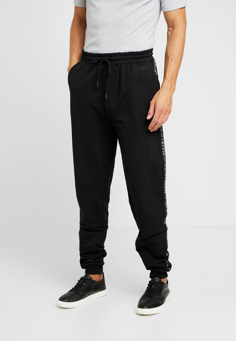 Guess - ZEPH PANTS - Trainingsbroek - jet black