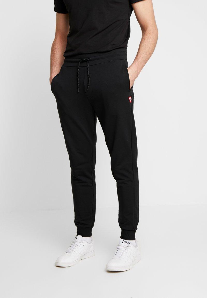 Guess - ADAM PANTS - Spodnie treningowe - jet black