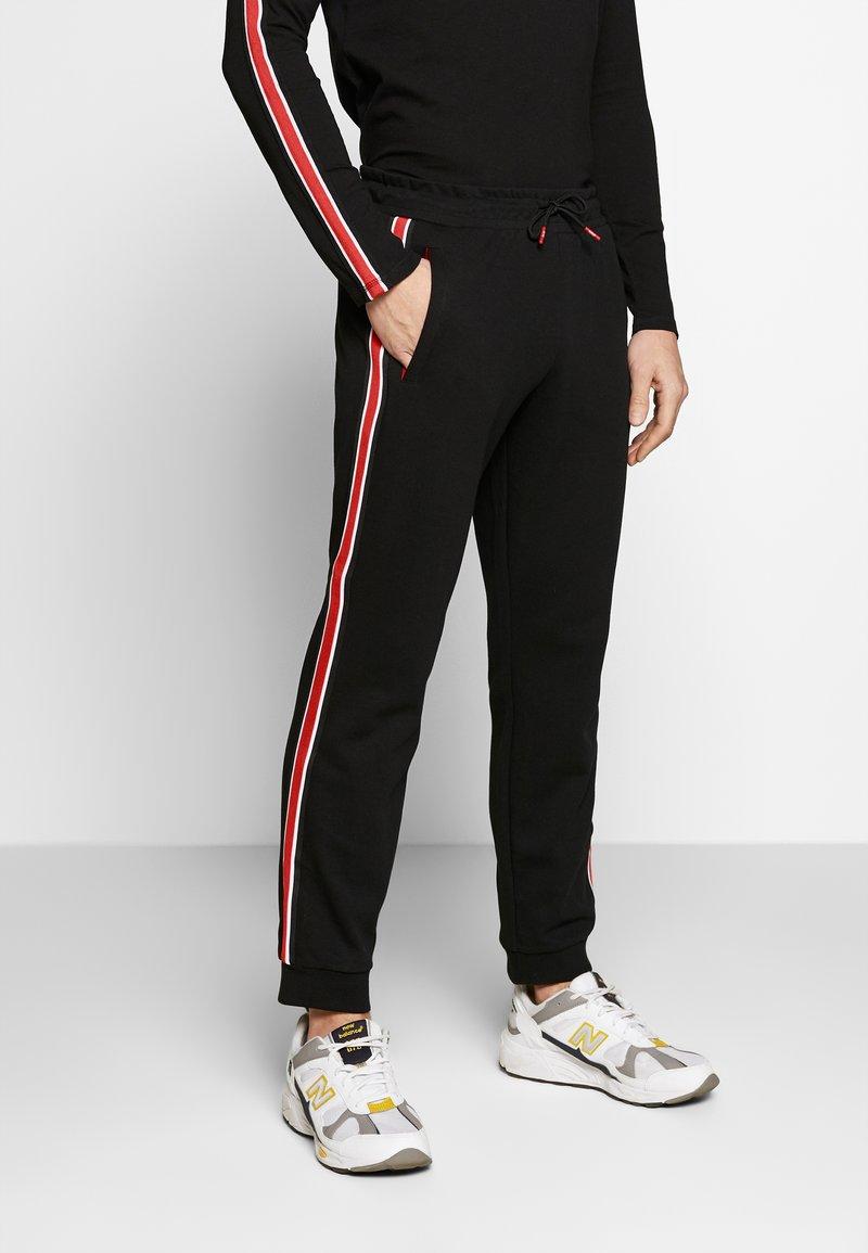 Guess - LEN PANTS - Pantalon de survêtement - jet black