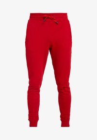 Guess - JAMES PANTS - Spodnie treningowe - red white combo