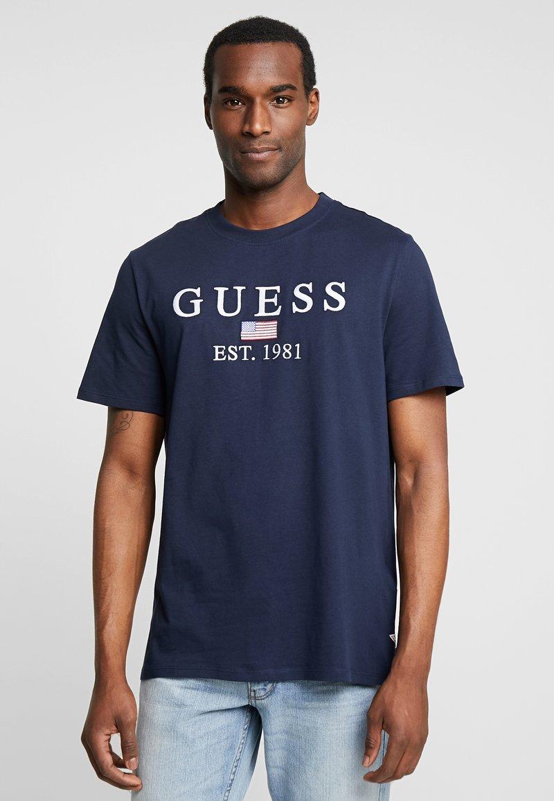 Guess - BELONG - Print T-shirt - blue navy
