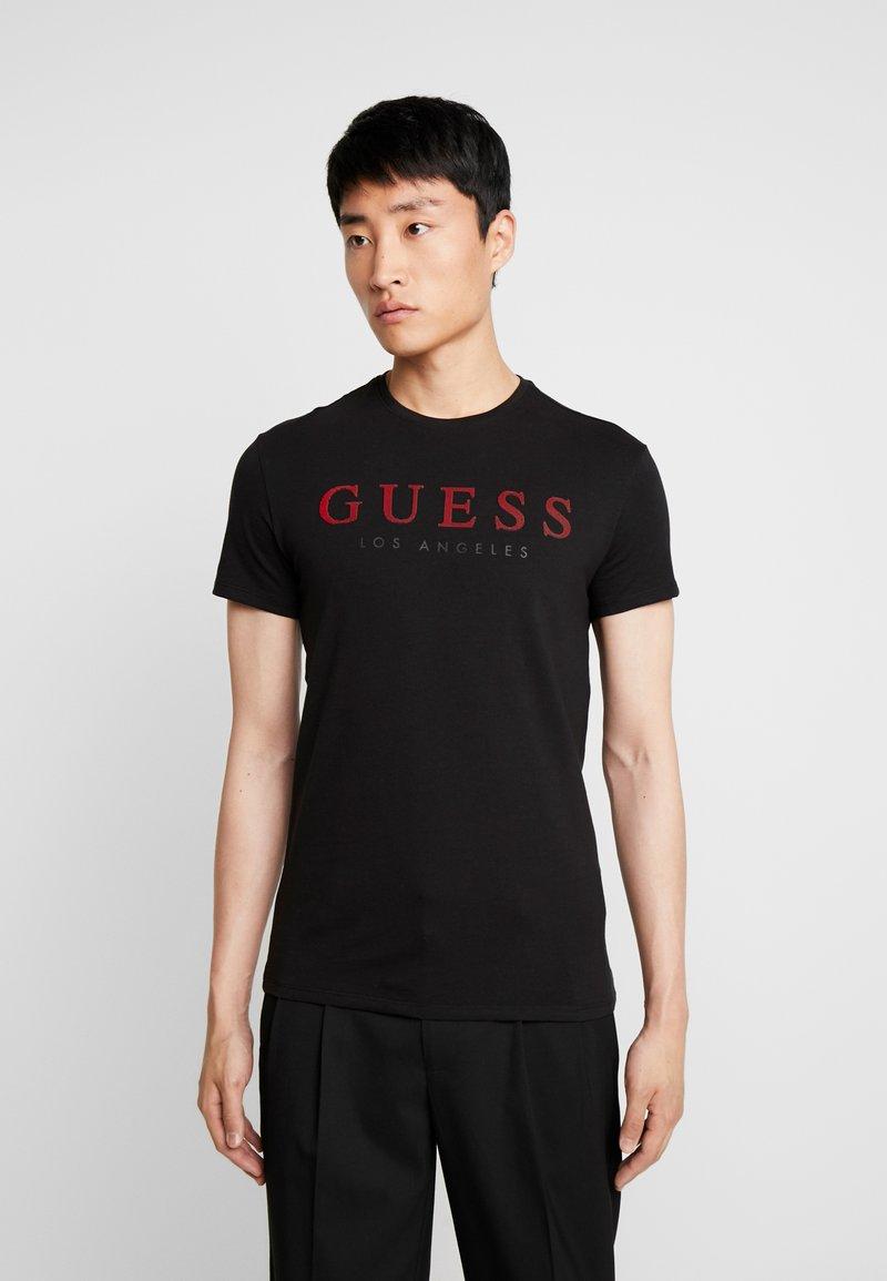 Guess - ORIGINAL CORE TEE - T-shirt con stampa - jet black