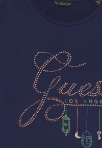 Guess - JUNIORSS CUT OUT SHOULDER - T-shirt imprimé - bleu/deck blue - 3