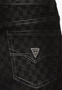 Guess - JUNIOR SKINNY PANTS - Jeans Skinny Fit - black/white - 3