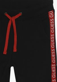 Guess - JUNIOR EXCLUSIVE ACTIVEWEAR - Pantalones deportivos - jet black - 4