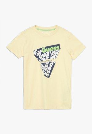 JUNIOR - Camiseta estampada - soft lemon