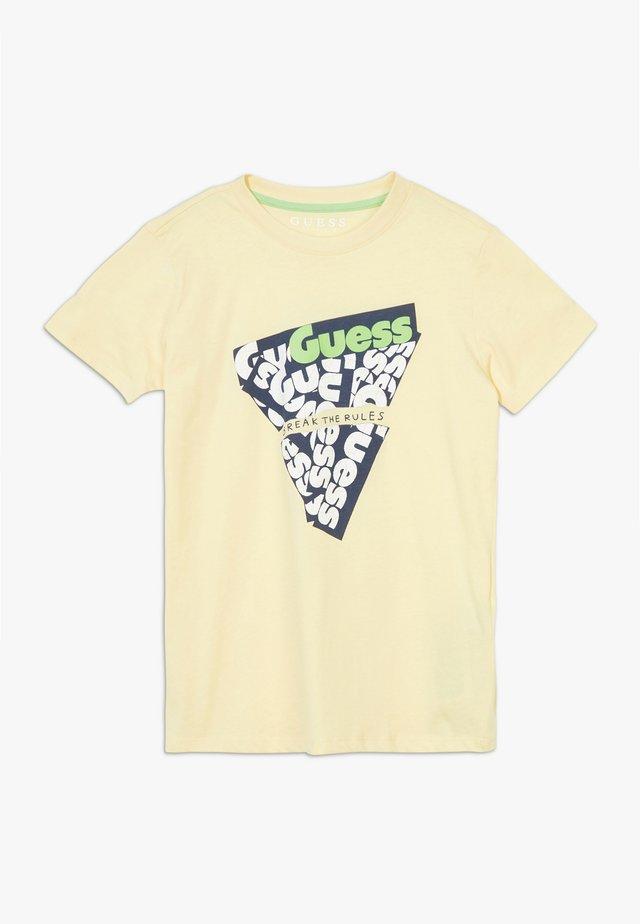 JUNIOR - T-shirt print - soft lemon