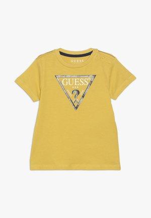 CORE BABY - Print T-shirt - gold rush yellow