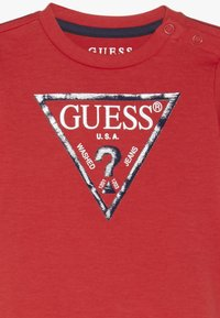 Guess - CORE BABY - Triko s potiskem - nora orange - 3