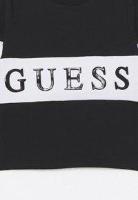 Guess - BABY - Top sdlouhým rukávem - jet black - 2
