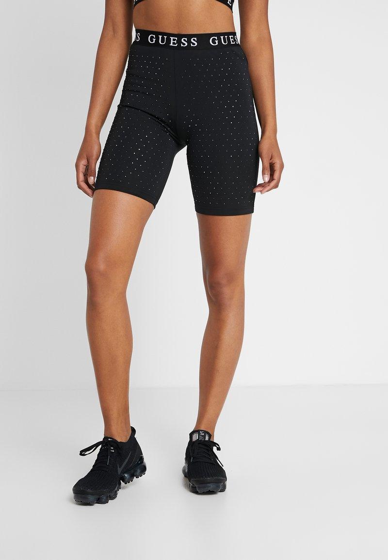Guess - LEGGINGS - Pantalón corto de deporte - jet black
