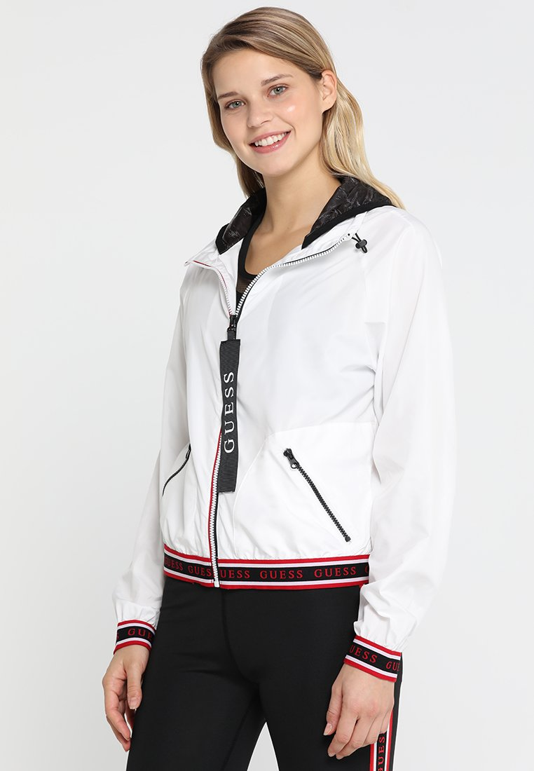 Guess - WIND SPORT JACKET - Veste de survêtement - optic white