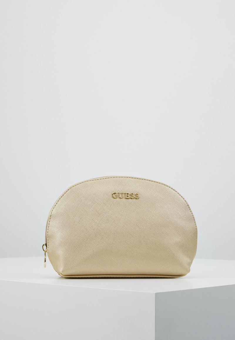 Guess - ARIANE DOME - Toalettmappe - gold