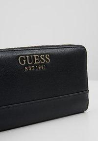 Guess - SHEROL LARGE ZIP AROUND - Wallet - black - 2