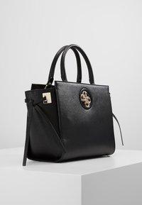 Guess - SOCIETY SATCHEL - Handbag - black - 3