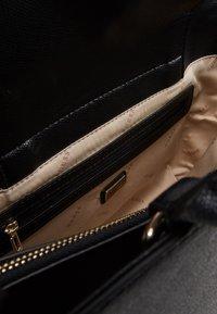 Guess - SOCIETY SATCHEL - Handbag - black - 4