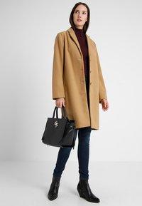 Guess - SOCIETY SATCHEL - Handbag - black - 1