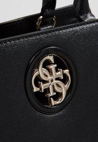 Guess - SOCIETY SATCHEL - Handbag - black - 6