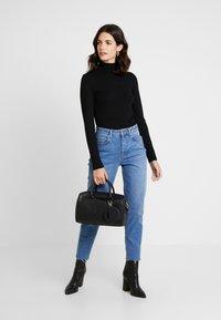 Guess - JANELLE BOX - Handbag - black - 1