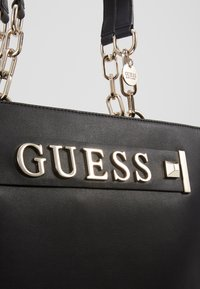 Guess - KERRIGAN  - Shopping bags - black - 6