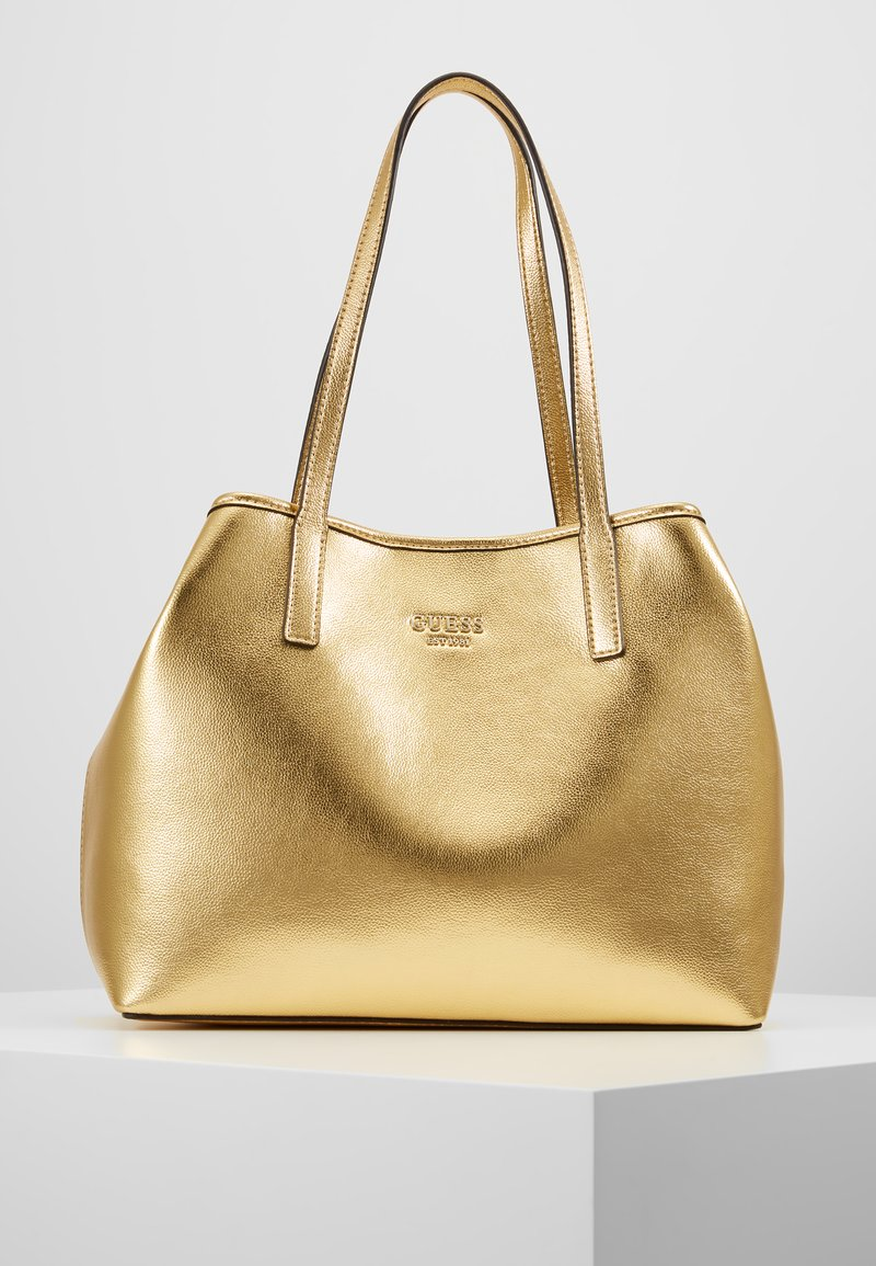 Guess - VIKKY TOTE SET - Handbag - gold