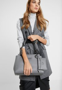 Guess - TARA GIRLFRIEND SATCHEL - Handbag - grey - 1