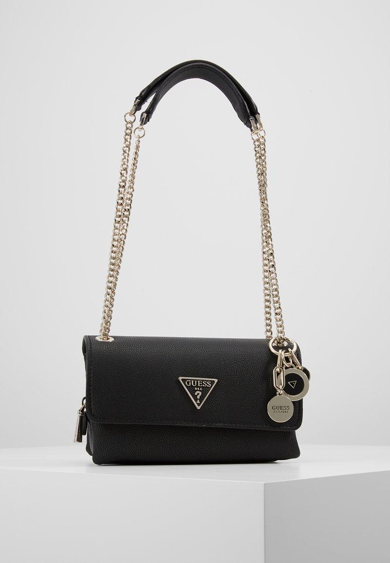 Guess - NARITA CONVERTIBLE CROSSBODY - Handbag - black