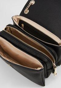 Guess - NARITA CONVERTIBLE CROSSBODY - Handbag - black - 5