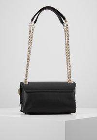 Guess - NARITA CONVERTIBLE CROSSBODY - Handbag - black - 3