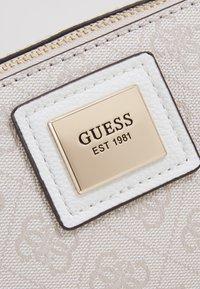 Guess - CANDACE MINI CROSSBODY - Bolso de mano - grey - 2