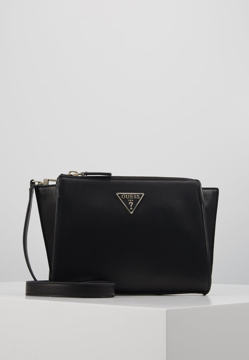 Guess - TANGEY MINI CROSSBODY TOP ZIP - Across body bag - black