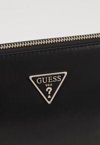 Guess - TANGEY MINI CROSSBODY TOP ZIP - Across body bag - black - 2
