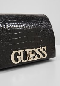 Guess - UPTOWN CHIC MINI XBODY FLAP - Umhängetasche - black - 6