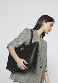 Guess - OPEN ROAD TOTE - Handbag - black - 1