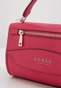 Guess - LIAS TOP HANDLE FLAP - Bolso de mano - pink - 6