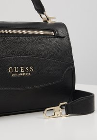 Guess - LIAS TOP HANDLE FLAP - Handtas - black - 5
