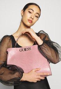 Guess - UPTOWN CHIC - Handbag - pink - 1